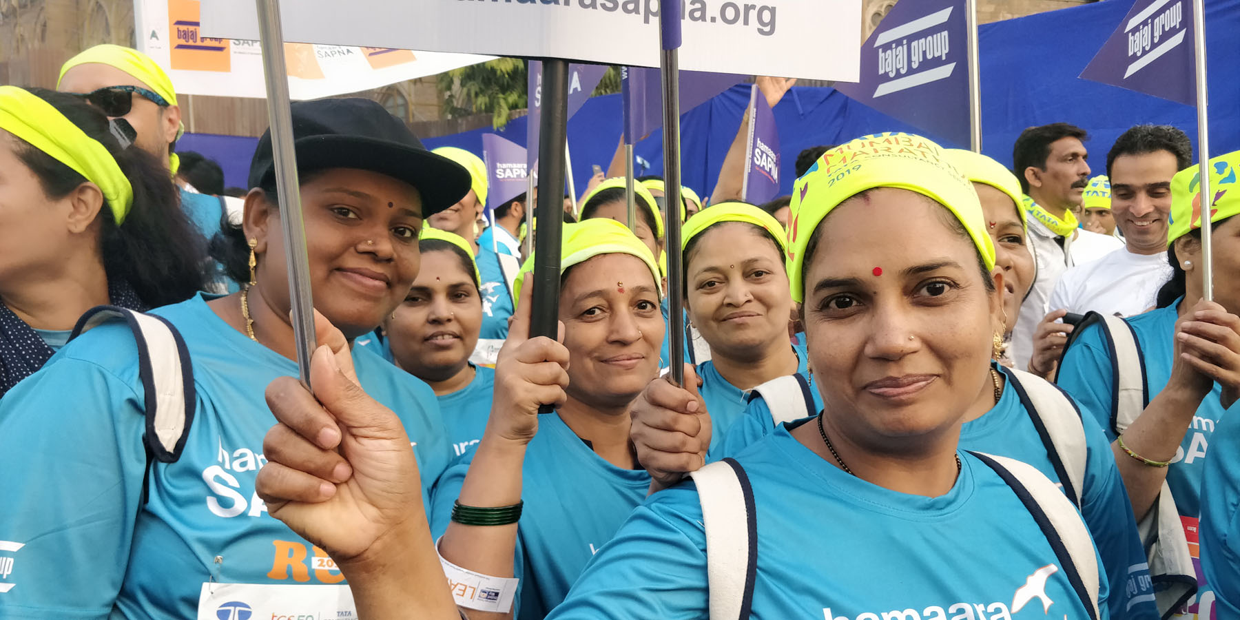Dharavi Centre beneficiaries with staff of Dharavi Centre in the Marathon. They are proud to carry the placards and represent Hamaara Sapna