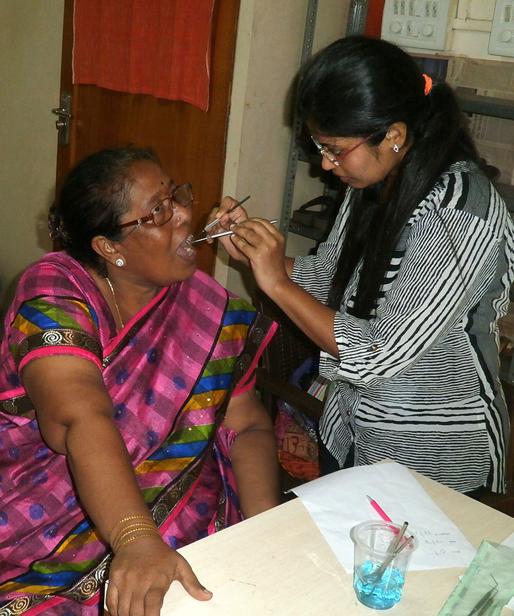 Dr. Rucha Baphna checking the teeth of a beneficiary (October, 2016)