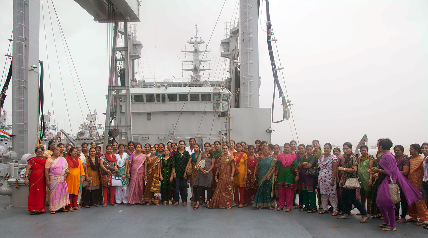 Beneficiaries standing outside the INS Deepak (July, 2013)