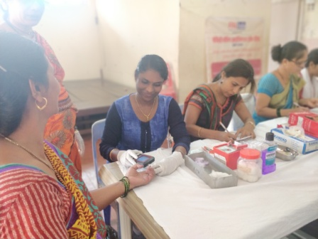 A beneficiary getting her haemoglobin test done by the staff of Kutumb Sudhar Kendra who had come to carry out a haemoglobin test for the staff and beneficiaries of Hamaara Sapna