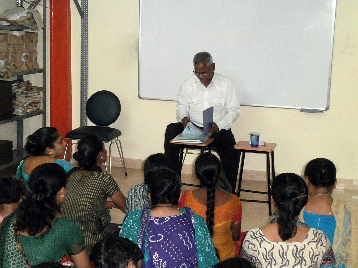 Mr. Anil Choubey explaining the laws for women (March, 2014)